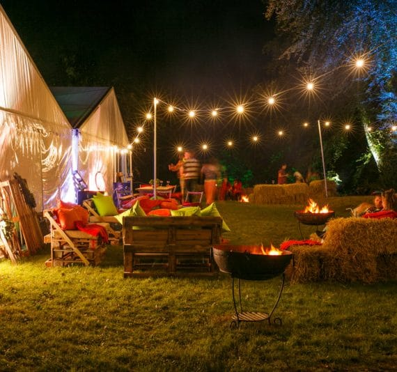 Carnival 21st birthday party planned - bale sofas and outdoor seating area