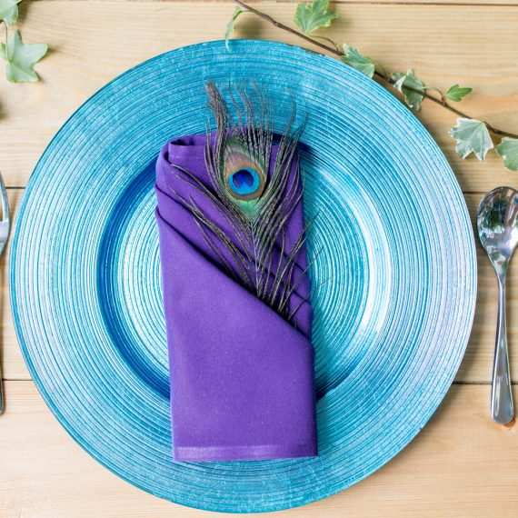 place setting woodplank tables with colourful crockery and linen (peacock feather)