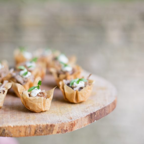 event food canapes presented on wood slice