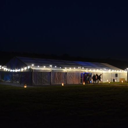 1980s neon theme birthday party - festoon lighting outside the marquee