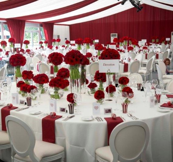 Marquee weddings with a bespoke tack off finish and burgundy red overlays and luxury dining chairs
