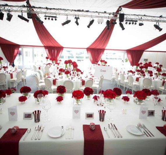 Marquee weddings with a bespoke tack off finish and burgundy red overlays