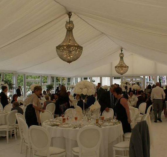 Marquee weddings - white flat linings and huge chandeliers