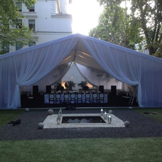 Marquee weddings with a bespoke finish - reveal curtain in white voile