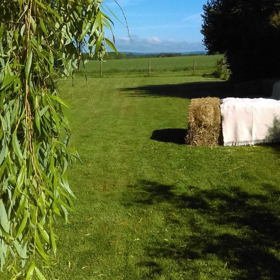Summer lunch with a view - hay bale sofa