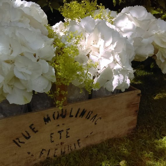 wine box and hydrangeas