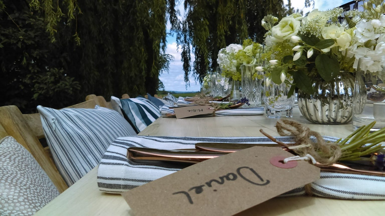 Copper cutlery and striped napkins