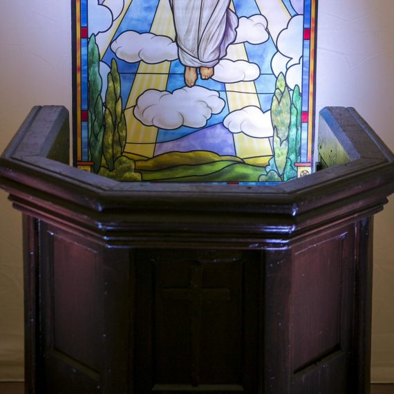 Pulpit close up with stained glass window