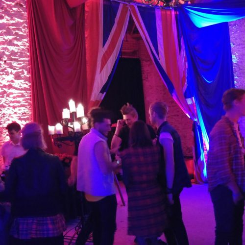 guests mingling during punk theme party