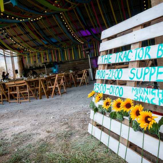 Pallet signage to welcome diners to the Tractor Barn