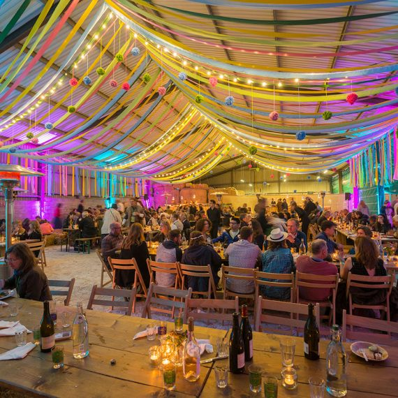 The agricultural barn lit and dressed for dining