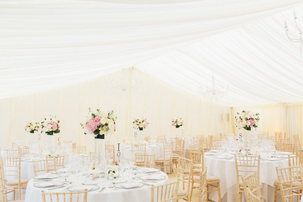 Neutral wedding marquee with reveal curtain