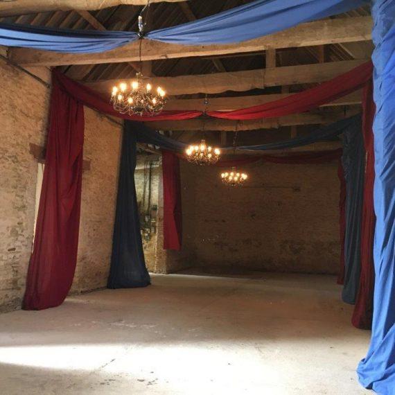 Fabric drapes to dress the stone barn venue