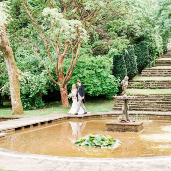 Bride and Groom in grounds of Cornwell Manor