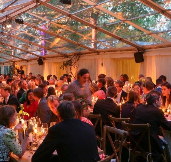 A marquee full of dinner guests